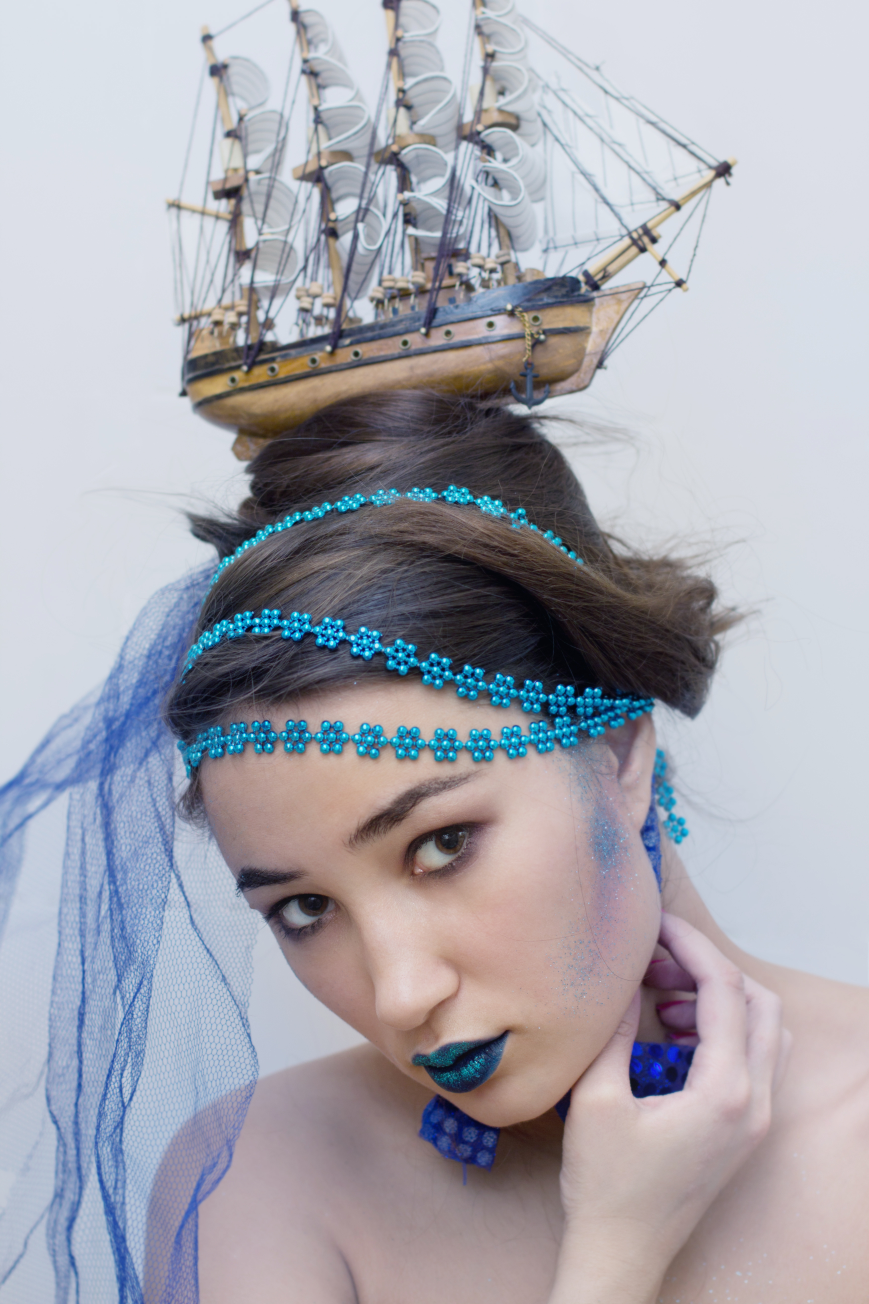 girl with boat on head