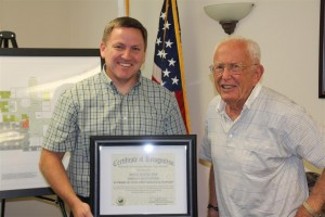 Brent Green receives a special certificate of recognition for Green Accounting's 40 years of service to the Soledad Community Health Care District